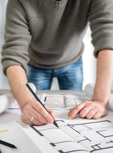architect architecture drawing project designer blueprint office business working architectural construction design work ruler table workplace people concept - stock image